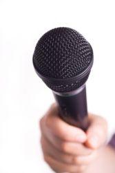 Microphone Held Toward Viewer